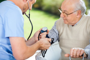 male nurse checking blood pressure