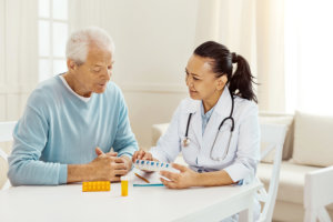 doctor giving instruction in taking the medicines